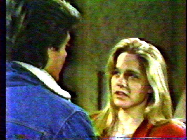 Screen shot of Frank Runyeon and Lindsay Frost in As the World Turns (1985).
